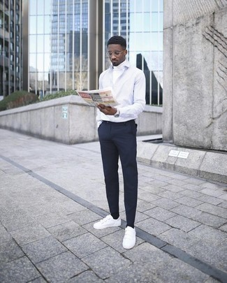 How to Wear Shoes For Men: This casual pairing of a white turtleneck and navy chinos is a tested option when you need to look dapper in a flash. To bring a more laid-back finish to this outfit, add white canvas low top sneakers. This combination illustrates that in your 20s your dressing options are looking great.