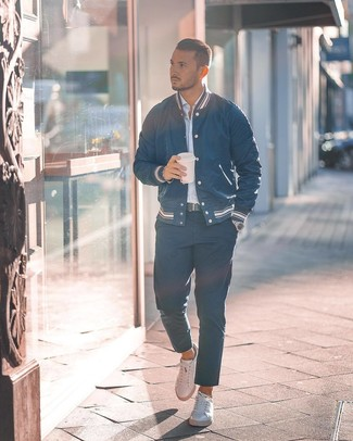 How to wear: white leather low top sneakers, navy chinos, light blue vertical striped long sleeve shirt, navy varsity jacket