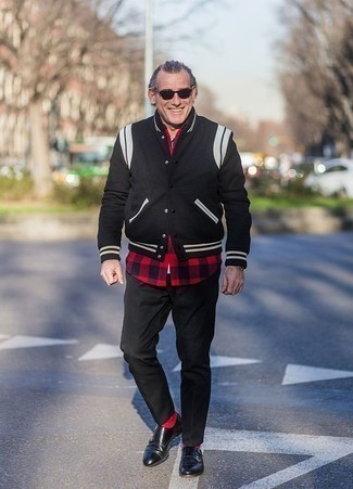 How to Wear a Black Varsity Jacket For Men: Such essentials as a black varsity jacket and black chinos are an easy way to infuse played down dapperness into your casual lineup. Let your sartorial expertise really shine by completing your look with a pair of black leather double monks.