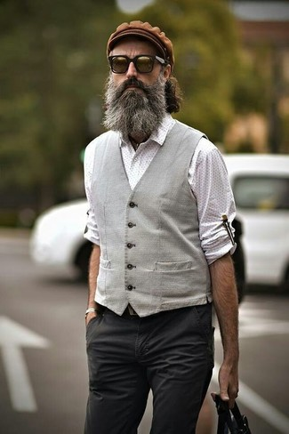 How to wear: brown flat cap, charcoal chinos, white polka dot long sleeve shirt, grey waistcoat