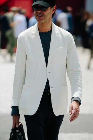 How to wear: black leather briefcase, black corduroy chinos, navy long sleeve t-shirt, white blazer