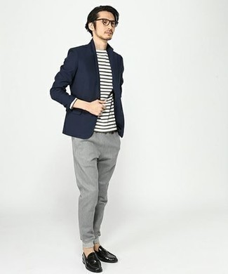 How to Wear a Navy Blazer For Men: This ensemble with a navy blazer and grey chinos isn't so hard to pull off and easy to change. Wondering how to complete your look? Round off with a pair of black leather loafers to dial up the classy factor.