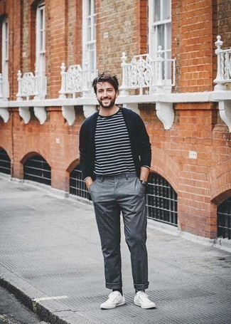 How to Wear a Navy Cardigan For Men: This laid-back and cool getup is super simple: a navy cardigan and grey chinos. White canvas low top sneakers are an easy way to inject a touch of stylish effortlessness into your outfit.