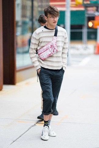 How to wear: white print leather low top sneakers, black chinos, black long sleeve t-shirt, beige horizontal striped crew-neck sweater