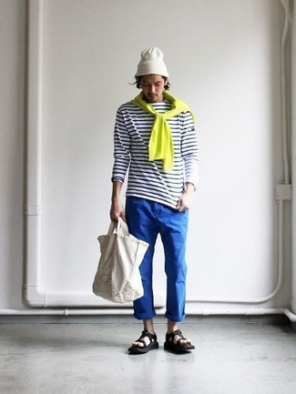 How to Wear a White Canvas Tote Bag For Men: Inject personality into your current collection with a green-yellow crew-neck sweater and a white canvas tote bag. To infuse a more laid-back feel into your outfit, introduce black canvas sandals to this getup.