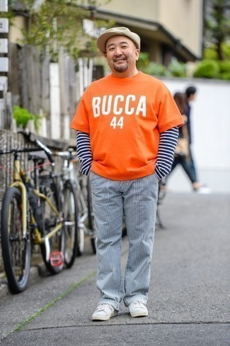 How to Wear White and Navy Vertical Striped Chinos: Choose an orange print crew-neck t-shirt and white and navy vertical striped chinos for equally stylish and easy-to-create look. Complement this look with grey suede low top sneakers and off you go looking killer.
