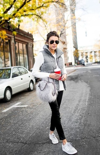 How to wear: grey low top sneakers, black chinos, white long sleeve t-shirt, grey quilted gilet