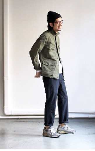 How to wear: grey suede athletic shoes, black chinos, white long sleeve t-shirt, olive military jacket