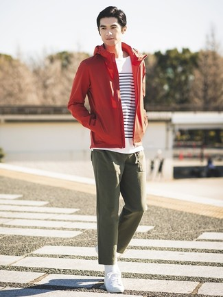 How to wear: white low top sneakers, olive chinos, white and navy horizontal striped long sleeve t-shirt, red windbreaker
