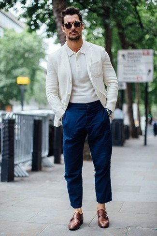 How to Wear a White Blazer For Men: A white blazer and navy chinos work together harmoniously. Here's how to give an added touch of style to this outfit: brown leather double monks.