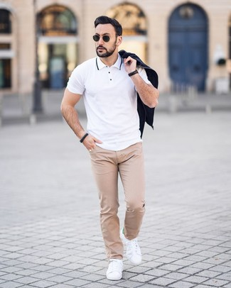 How to wear: white leather low top sneakers, beige polka dot chinos, white polo, black bomber jacket