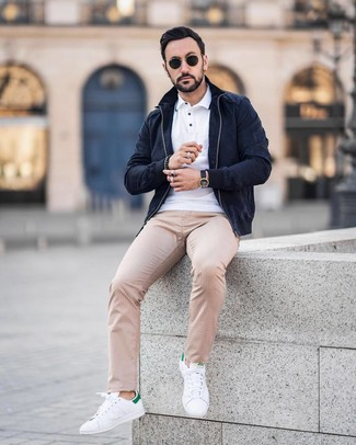 How to wear: white and green leather low top sneakers, beige polka dot chinos, white polo, navy suede bomber jacket