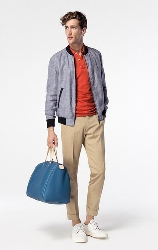 Men's Looks & Outfits: What To Wear In 2020: Go for a simple but at the same time laid-back and cool choice by pairing a light blue bomber jacket and khaki chinos. Take an otherwise standard look a whole other path by finishing off with a pair of white canvas low top sneakers.