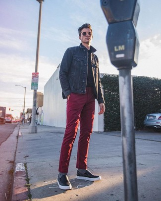 How to wear: black leather slip-on sneakers, burgundy chinos, black polo, navy denim jacket