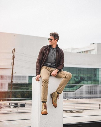 How to wear: tan canvas casual boots, khaki chinos, charcoal polo neck sweater, dark brown leather bomber jacket