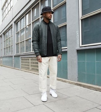 Men's Looks & Outfits: What To Wear In 2020: This casual combination of a dark green quilted bomber jacket and white chinos is extremely easy to put together without a second thought, helping you look dapper and ready for anything without spending too much time going through your wardrobe. Rounding off with a pair of white canvas high top sneakers is an effortless way to inject a playful feel into your ensemble.