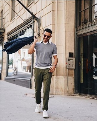 Men's Looks & Outfits: What To Wear In 2020: This ensemble with a navy denim shirt jacket and olive chinos isn't hard to score and easy to adapt. Finishing with white canvas low top sneakers is a fail-safe way to add a mellow vibe to your getup.