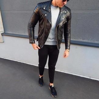 How to wear: black leather low top sneakers, black chinos, grey sweatshirt, black leather biker jacket