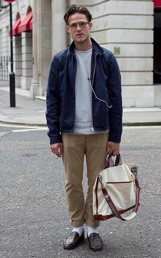 How to Wear a Navy Harrington Jacket: A navy harrington jacket and khaki chinos are the kind of a foolproof off-duty combination that you need when you have no time to dress up. For a classier vibe, introduce a pair of dark brown leather loafers to the mix.