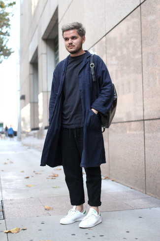 How to wear: white leather low top sneakers, black linen chinos, black sweatshirt, navy overcoat