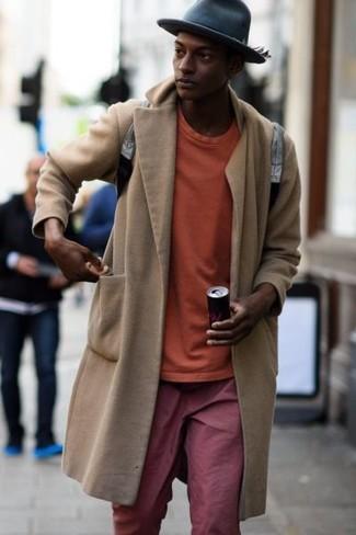 How to wear: grey leather backpack, red chinos, orange sweatshirt, beige overcoat