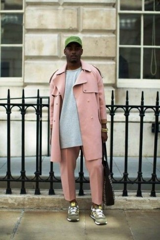 How to wear: olive suede athletic shoes, pink chinos, grey sweatshirt, pink trenchcoat