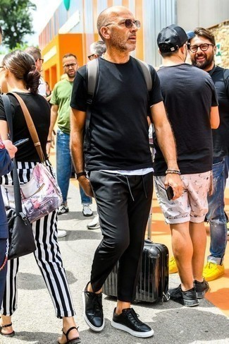How to Wear a White Tank For Men: This casually cool getup is really pared down: a white tank and black chinos. Enter a pair of black leather low top sneakers into the equation and the whole outfit will come together perfectly.