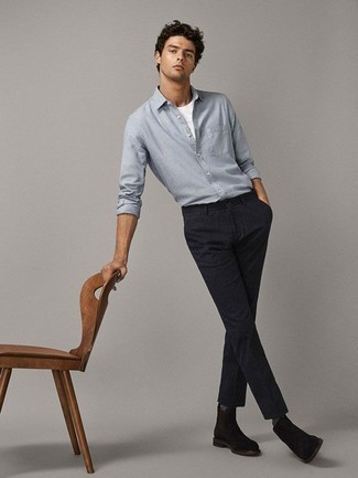 Men's Looks & Outfits: What To Wear In 2020: This laid-back pairing of a light blue chambray long sleeve shirt and navy vertical striped chinos is very easy to pull together in seconds time, helping you look awesome and ready for anything without spending a ton of time rummaging through your closet. Rev up the appeal of your outfit by finishing with a pair of dark brown suede chelsea boots.