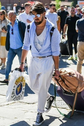 Men's Looks & Outfits: What To Wear In Hot Weather: If you enjoy functional style, pair a light blue linen long sleeve shirt with white chinos. Add a pair of black and white canvas high top sneakers to the mix to keep the outfit fresh.