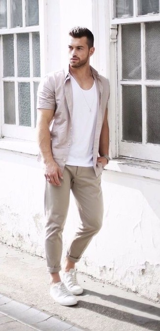 How to wear: white leather low top sneakers, beige chinos, white tank, beige short sleeve shirt