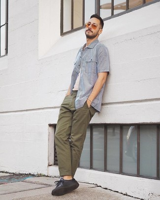 How to wear: black leather low top sneakers, olive chinos, white tank, white and blue vertical striped short sleeve shirt