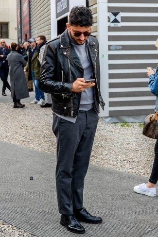 How to Wear a Black Leather Biker Jacket For Men: A black leather biker jacket and charcoal chinos have become indispensable wardrobe styles for most guys. Add a pair of black leather oxford shoes to your ensemble for a touch of elegance.