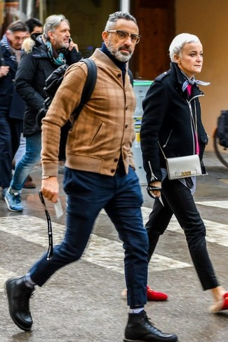 How to wear: black leather casual boots, navy chinos, navy turtleneck, tan leather bomber jacket