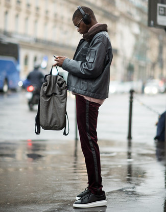 How to wear: black leather low top sneakers, burgundy corduroy chinos, pink knit turtleneck, black leather bomber jacket