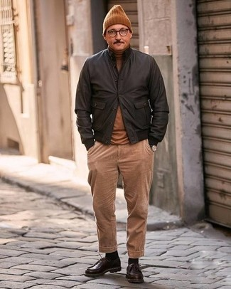 How to Wear Khaki Corduroy Chinos: A dark brown leather bomber jacket and khaki corduroy chinos paired together are the ideal combination for gents who appreciate casual and cool looks. Amp up this whole ensemble by rocking a pair of dark brown leather derby shoes.