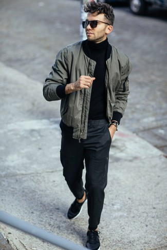 How to Wear Black Sunglasses For Men: Marry a dark green bomber jacket with black sunglasses to be both urban and functional. Amp up the cool of this look by finishing off with black low top sneakers.
