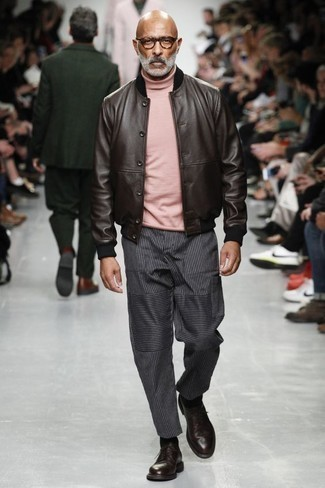 How to Wear a Pink Turtleneck For Men: If you gravitate towards off-duty looks, why not try this combination of a pink turtleneck and charcoal vertical striped chinos? Burgundy leather derby shoes are a guaranteed way to inject a dose of sophistication into your outfit.