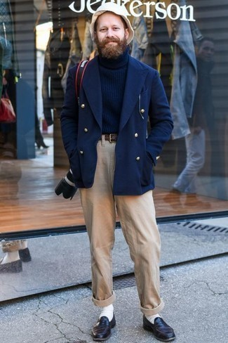 How to Wear Khaki Chinos: Prove that you do smart casual menswear like a pro by opting for a navy double breasted blazer and khaki chinos. A pair of dark purple leather loafers instantly elevates the look.