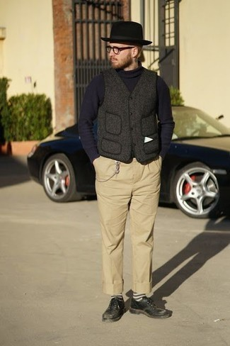 How to Wear Black Leather Derby Shoes: This combination of a charcoal wool gilet and khaki chinos is undeniable proof that a straightforward casual outfit can still look truly dapper. As for the shoes, you could stick to a classier route with black leather derby shoes.
