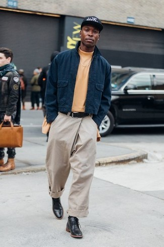 How to Wear a Harrington Jacket: A harrington jacket and beige chinos matched together are a perfect match. For extra fashion points, introduce black leather desert boots to this look.