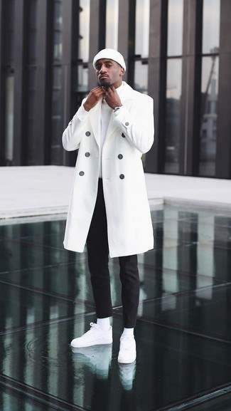How to wear: white leather low top sneakers, black chinos, white turtleneck, white overcoat