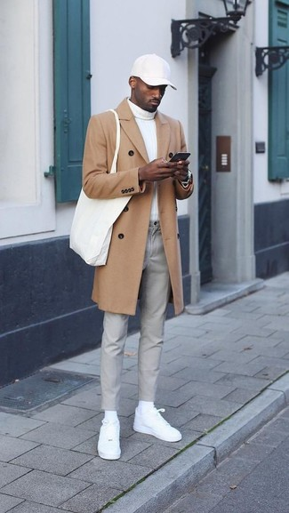 How to wear: white leather low top sneakers, grey chinos, white turtleneck, camel overcoat