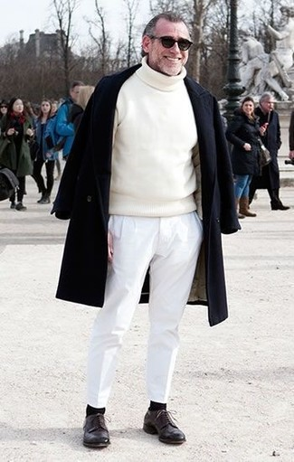 How to wear: dark brown leather derby shoes, white chinos, white turtleneck, black overcoat