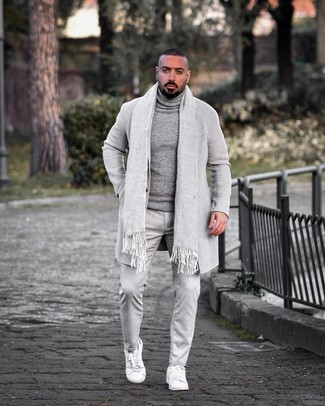 How to wear: white leather low top sneakers, grey chinos, grey wool turtleneck, grey overcoat