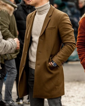 How to wear: black leather watch, charcoal wool chinos, beige turtleneck, brown overcoat