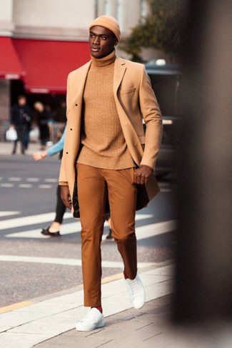 How to wear: white leather low top sneakers, tobacco chinos, tan turtleneck, camel overcoat