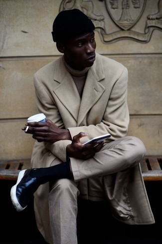 How to Wear Beige Chinos: A beige overcoat and beige chinos are worth adding to your list of indispensable menswear items. A pair of black leather slip-on sneakers will add a fun feel to your getup.