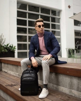How to Wear a Pink Turtleneck For Men: Such must-haves as a pink turtleneck and beige chinos are an easy way to inject muted dapperness into your daily casual fashion mix. You can get a bit experimental when it comes to shoes and dial down your outfit by sporting white canvas low top sneakers.