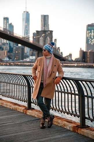 Men's Looks & Outfits: What To Wear In Winter: For an ensemble that's worthy of a modern sartorial-savvy gent and casually sleek, consider pairing a camel overcoat with dark green chinos. A pair of dark brown leather casual boots makes this look complete. With an ensemble like this in your winter closet, you're guaranteed to stay snug and look stylish despite the subzero temperatures.