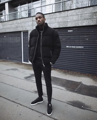 How to Wear a Black Puffer Jacket For Men: This combo of a black puffer jacket and black chinos can only be described as seriously stylish and effortlessly classic. Have some fun with things and complete your outfit with a pair of black canvas low top sneakers.